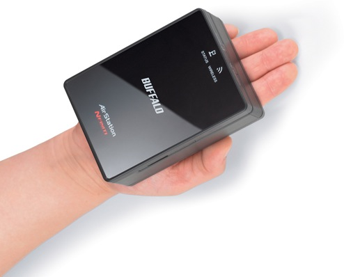 Buffalo WLAE-AG300N Nfiniti Wireless-N Dual Band Ethernet Converter, Access Point and Bridge in Hand