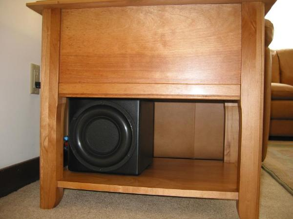 Speakers include ADS 250LCR for the front and center, Carver Sunfire True Sub Jr sub woofer and two Bose cubes for the rear surround.